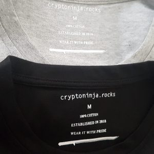 Two overlapping T-shirt collars with visible cryptoninja label inside press on the neck.